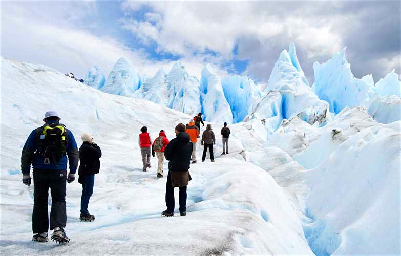 A group of tourists ice-trekking on the Perito Moreno Glacier in Patagonia, Argentina. Image by Rachel Lewis / Lonely Planet Images / Getty Images .