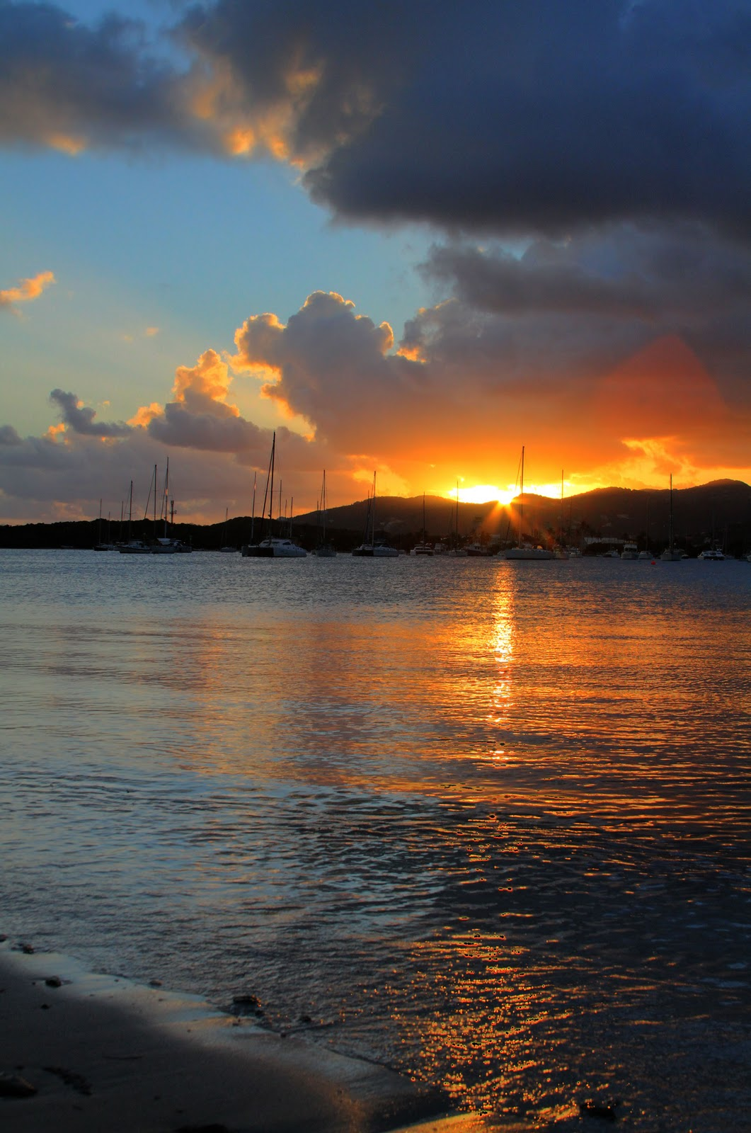 Where you can watch the sunset within the bvi cotton chocolate pink skies and